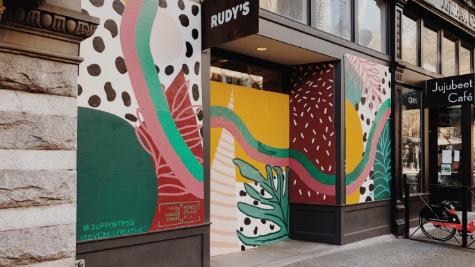 Rudy's mural created by Overall Creative, sponsored by the Alliance for Pioneer Square and Pioneer Square BIA.